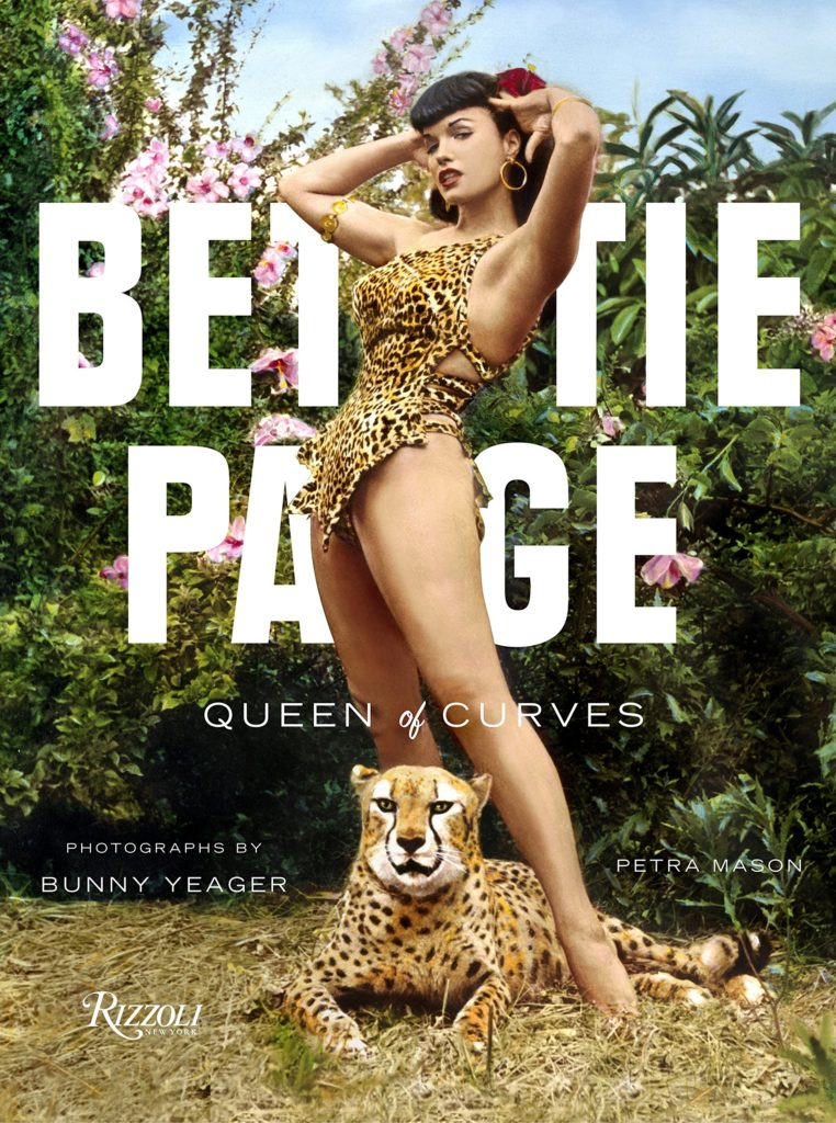 Book cover of Bettie Page: Queen of Curves which features her leopard print swimsuit and one of the cheetahs.