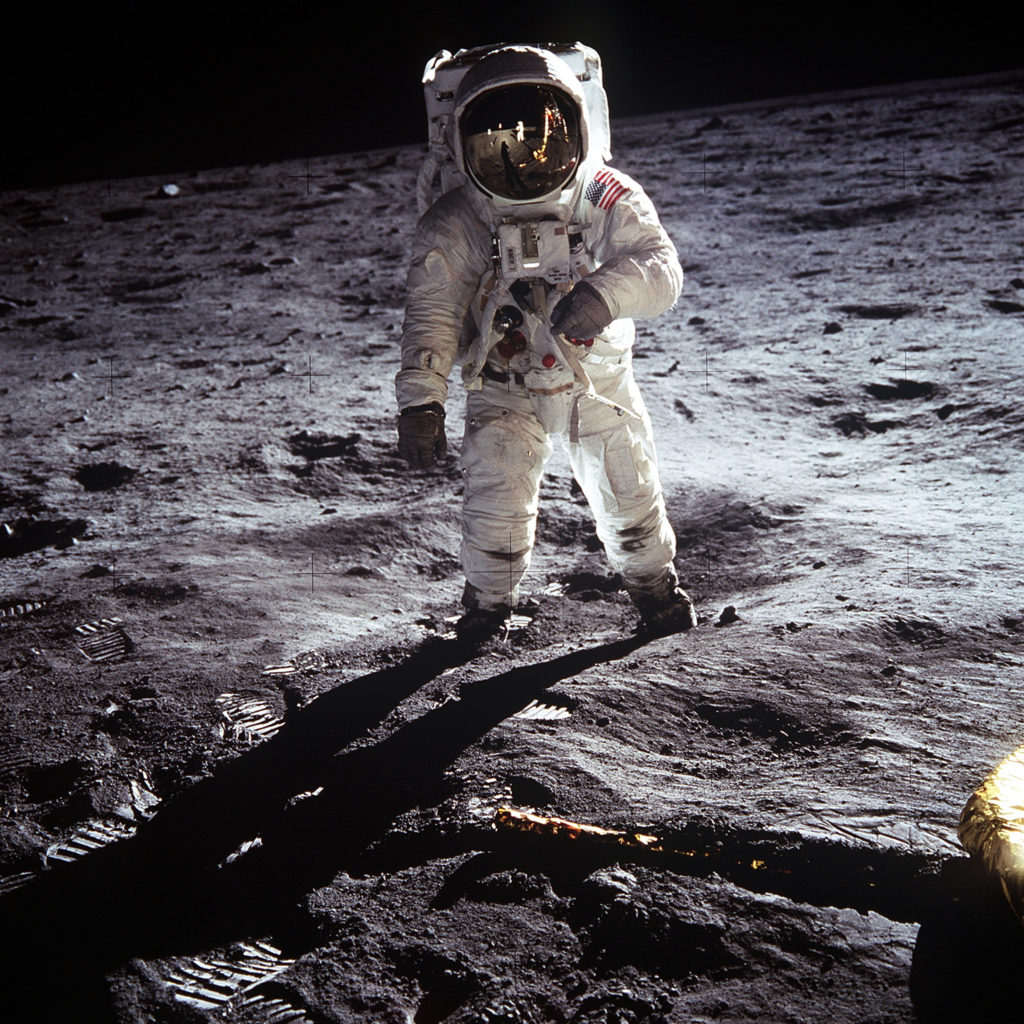Astronaut Buzz Aldrin walks the surface of the moon during the Apollo 11 voyage.