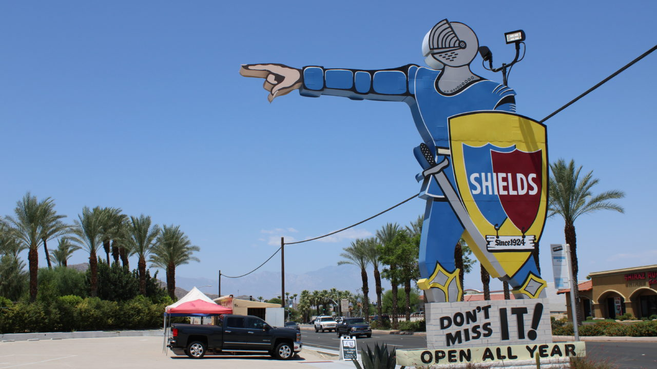 Shields Date Garden sign is a huge knight pointing at the store, since 1950s.