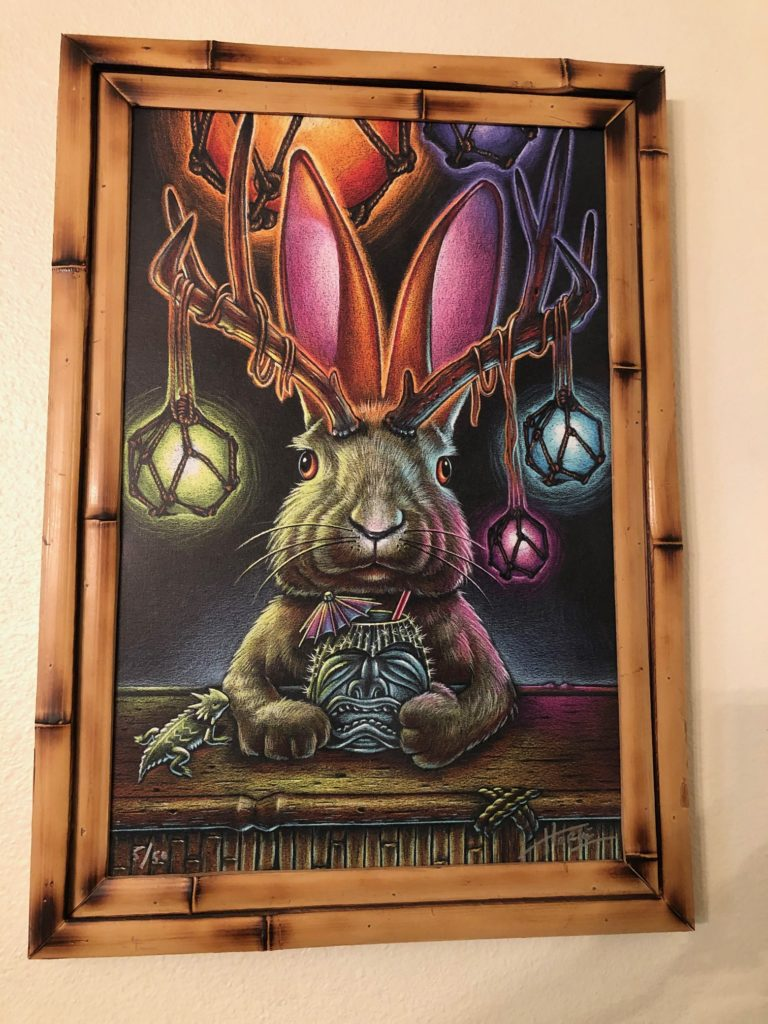 Painting of a Jackalope (rabbit with antlers) that has Japanese fishing floats in his antlers and sips on a Tiki drink.