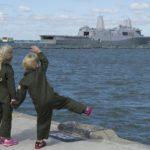 Navy Brats waving at ship