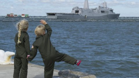 Navy Brats waving at ship