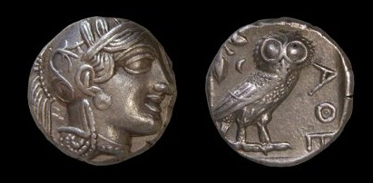 The silver drachma coins of Greece with Athena's face on one side and the owl holding an olive branch from 454-415 B.C.