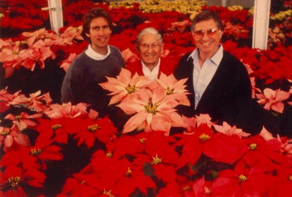 Three generations of Paul Ecke family standing in the poinsettia greenhouse on their ranch in San Diego.