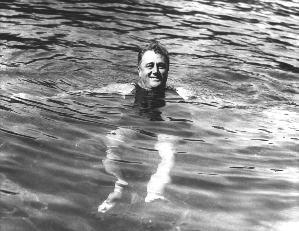 FDR smiling while swimming at Warm Springs Resort.