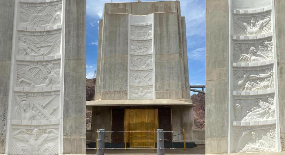 Bas-relief panels over golden elevators