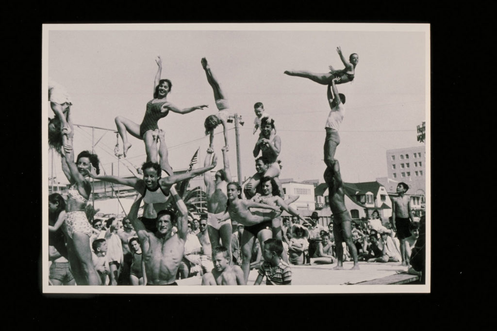 Crowd of athletes performing at Muscle Beach