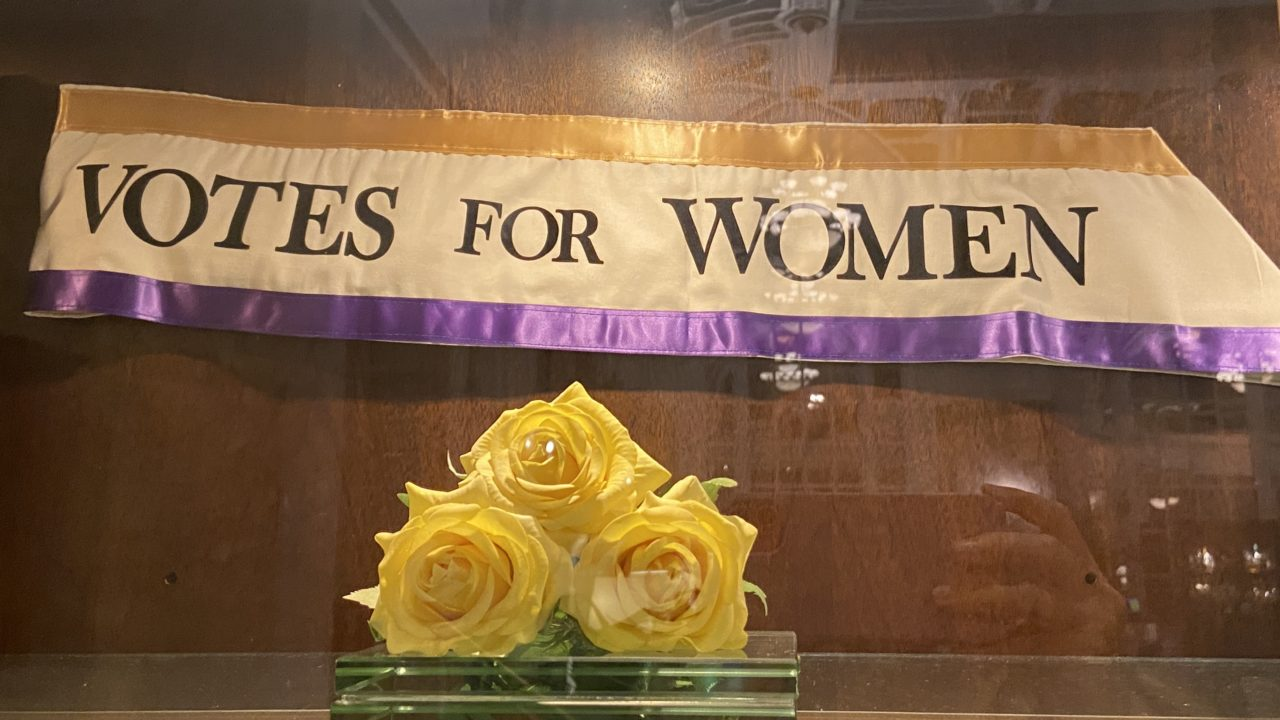 Banner and yellow roses