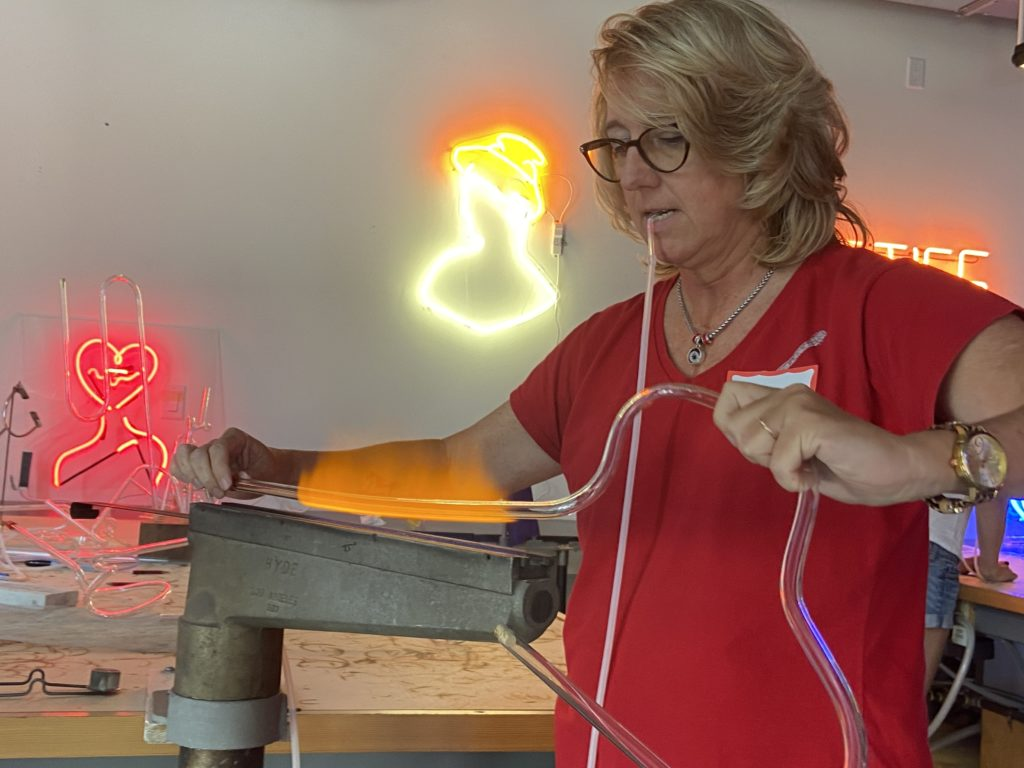 Author holds glass tube over flame to bend it