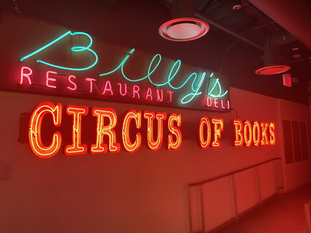 Neon sign with multiple lettering styles